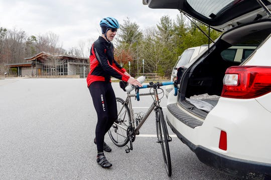 """Marc Miller, of Fines Creek, puts his bicycle back into his vehicle after a 25-mile ride on the Blue Ridge Parkway Feb. 27, 2019. """"There's something about being on the Parkway that is very uplifting, very freeing,"""" said Miller, who wanted to get another ride in before turning 63 the next day. The Parkway had more than 1 million fewer visitors in 2018, due to weather, repairs and the government shutdown, knocking it off the No. 1 spot in the National Park Service."""