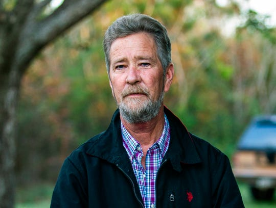 In this Dec. 5, 2018 file photo, Leslie McCrae Dowless Jr. poses for a portrait outside of his home in Bladenboro. The North Carolina political operative at the center of a ballot fraud scandal is facing criminal charges for his activities in the 2016 elections and the Republican primary in 2018. Wake County District Attorney Lorrin Freeman said Wednesday, Feb. 27, 2019, that Dowless was arrested after grand jury indictments alleging illegal possession of absentee ballots and obstruction of justice.