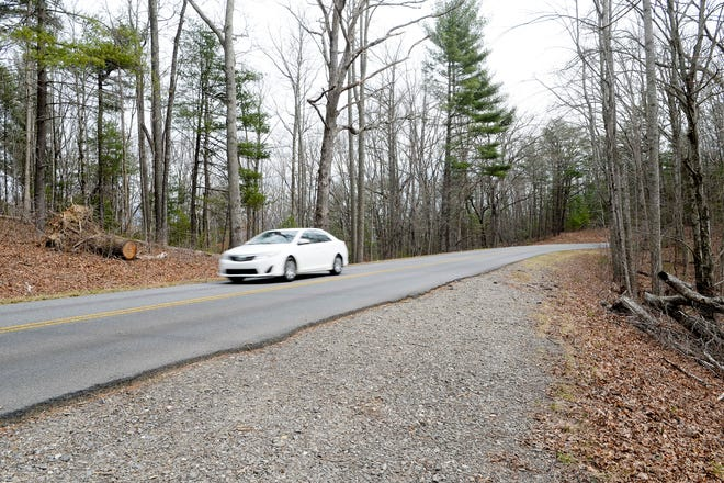 A car passes through Feb. 27, 2019, where a tree once blocked the Blue Ridge Parkway. The Parkway had more than 1 million fewer visitors in 2018, due to weather, repairs and the government shutdown, knocking it off the No. 1 spot in the National Park Service.