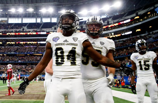 Western Michigan Broncos wide receiver Corey Davis (84) celebrates with Luke Juriga (59) after catching a touchdown pass during the second half of the 2017 Cotton Bowl against the Wisconsin Badgers at AT&T Stadium.