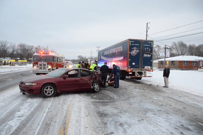 Emmett Township police said a car slid out of control early Wednesday and collided with a semi. Three teenagers were hurt.