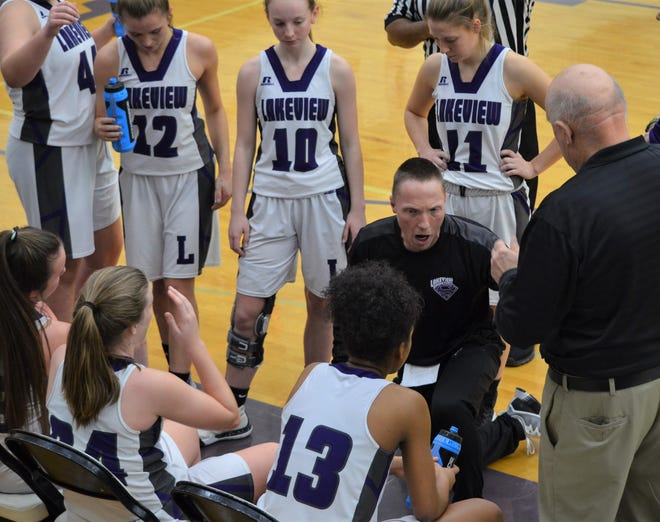 Lakeview girls basketball coach Don Bussler talks to his team during the second half of an emotional contest against rival Battle Creek Central.