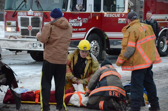 Firefighters treat one of the injured teenage girls in a Wednesday morning crash.
