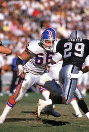 Jim Juriga (66) of the Denver Broncos matches up against defensive back Russell Carter (29) of the Los Angeles Raiders during a game at Los Angeles Memorial Coliseum on December 3, 1989 in Los Angeles, California.