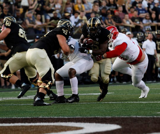 Western Michigan guard Luke Juriga (59) paves the way for running back Jamauri Bogan (32) against Delaware State at Waldo Stadium in Kalamazoo on Sept. 15, 2018.