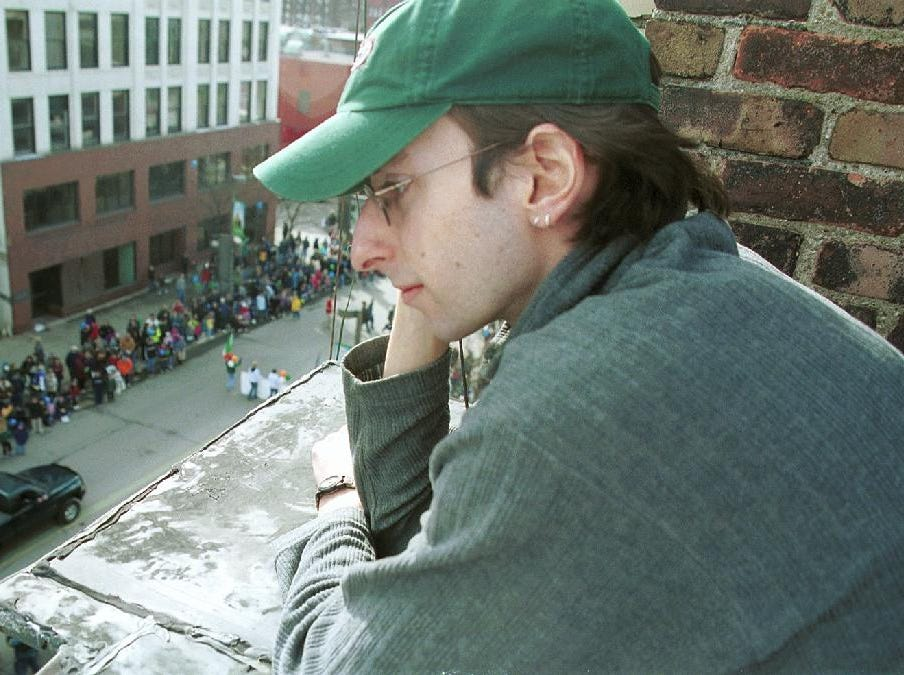 2000: Dan Kutz, Binghamton University graduate student, watches the annual St. Patrick's Day Parade in Binghamton from a roof top next to his apartment.