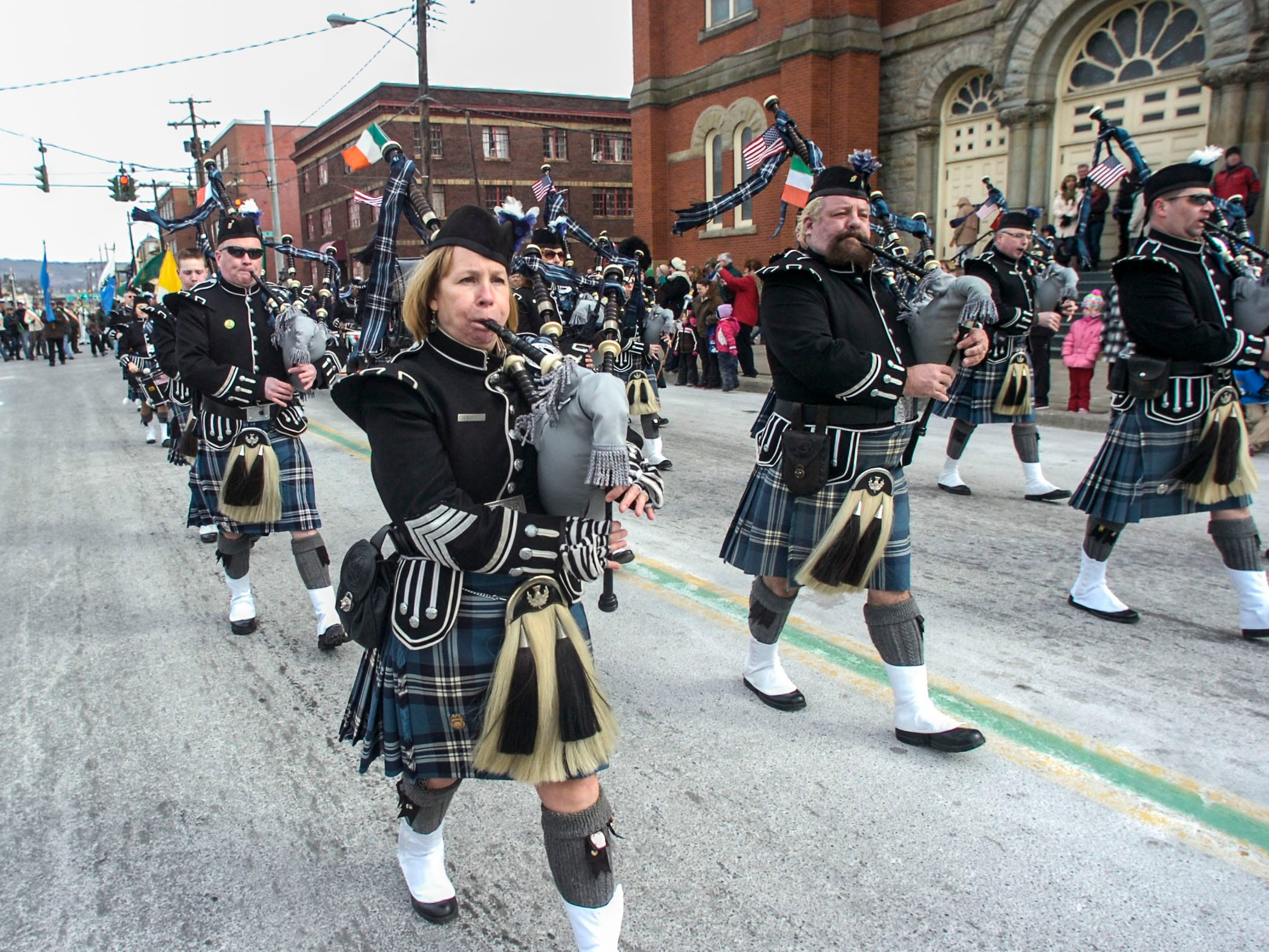 2014: The B.C. Celtic Pipes & Drums march past St. Mary of Assumption on Court Street in the 47th annual St. PatrickÕs Day Parade in downtown Binghamton on Saturday.
