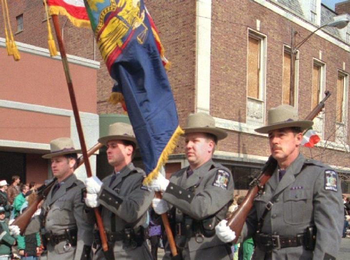 1998: New York State Poilce Color Guard members from left Sergerant Edward Abruzzo, Trooper Joseph Banish, Trooper Stephen Long and Trooper Ward Coe march in the annual St. Patricks Day parade held recently in downtown Binghamton.