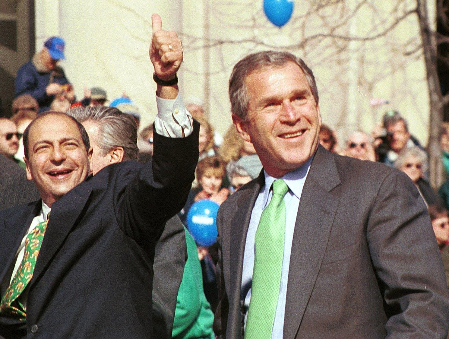 2000: The annual St.Patrick's Day parade in Binghamton had a few more people than usual including from left, State Senator Thomas Libous and Presidential Candidate George W. Bush. March 4, 2000.