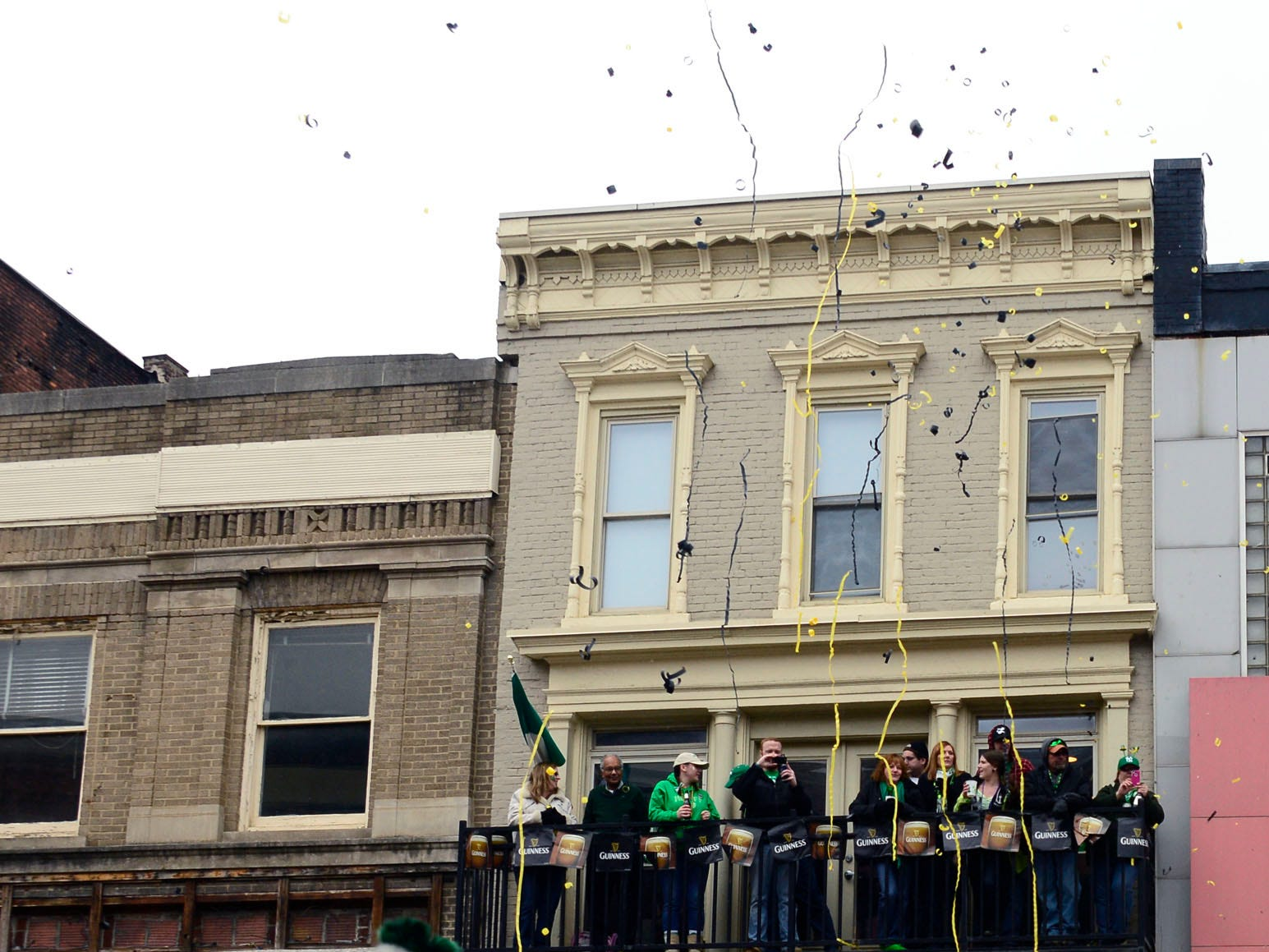 2013: Crowds shoot confetti into the air as the Ladies From Hell Pipe Band passes by during the St. Patrick's parade in Binghamton on Saturday, March 2, 2013.