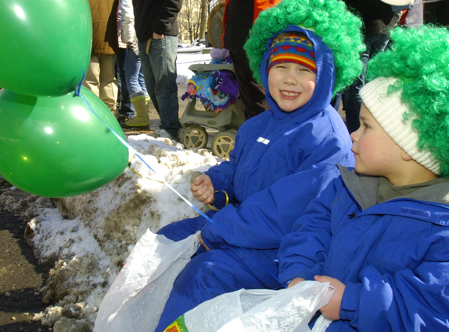 2006: Hunter Gulbin, 7, left, and brother Levi, 3, enjoy front row seats at the St. Patrick's Day Parade in Binghamton on Saturday.