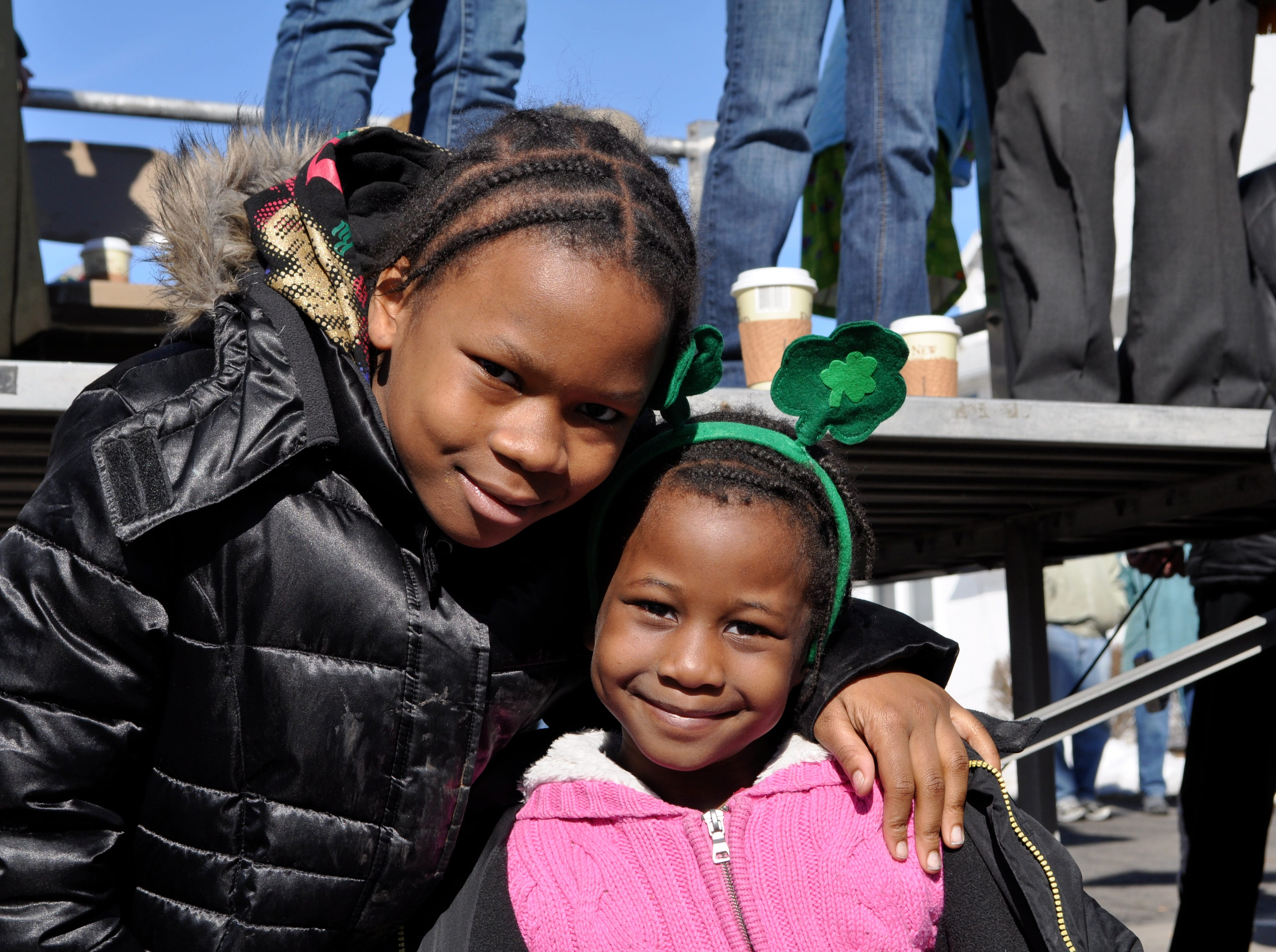 2010: Ronysha Green, 11 and Laylay Graves, 6, of Binghamton, enjoy the St. Patrick's Day parade in downtown Binghamton on Saturday.