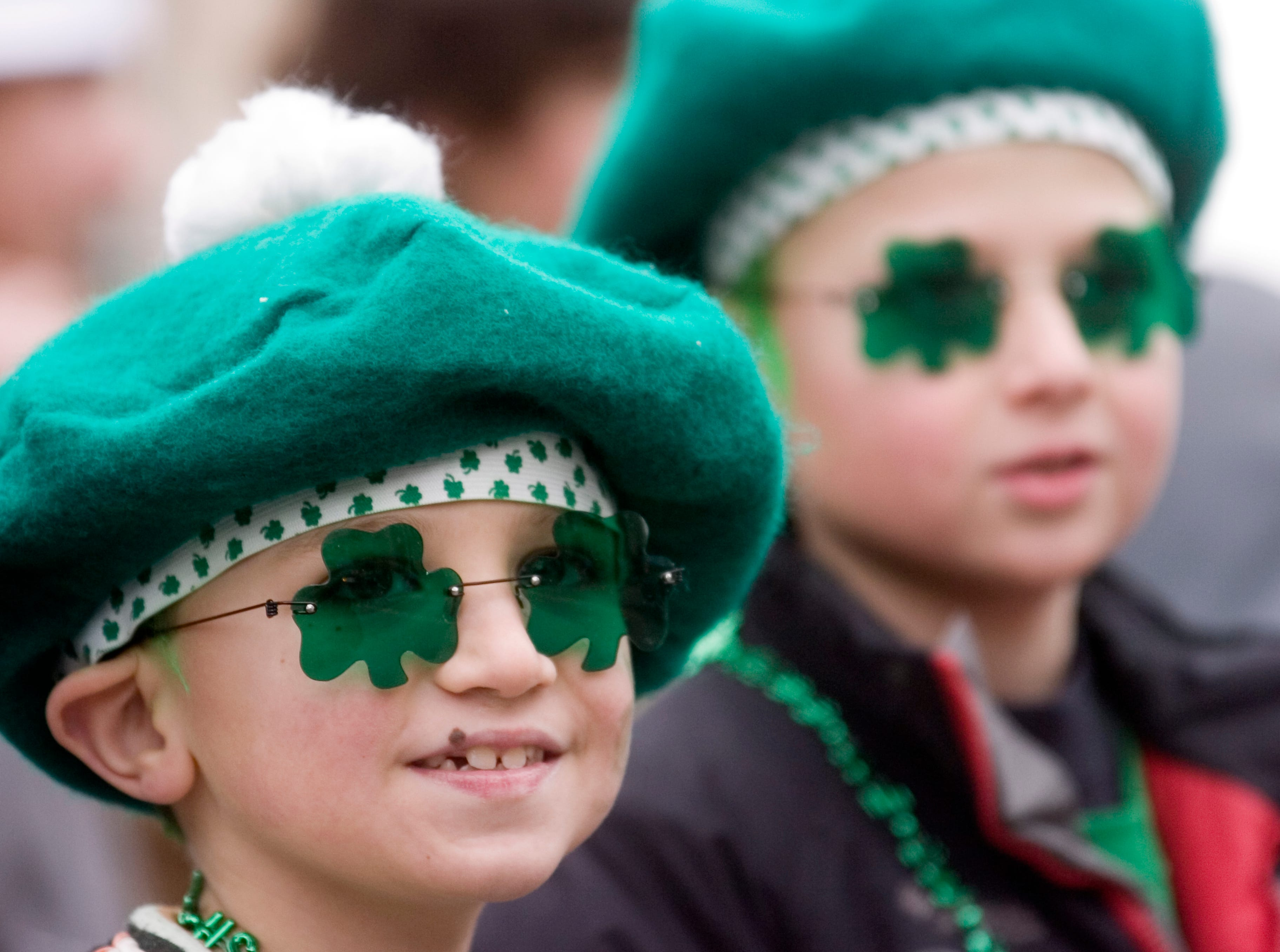 2007: Trenten Crocker, 7, left, and brother Cameron, 9 of Johnson City watch the annual Binghamton St. PatrickÕs Day Parade on Saturday.