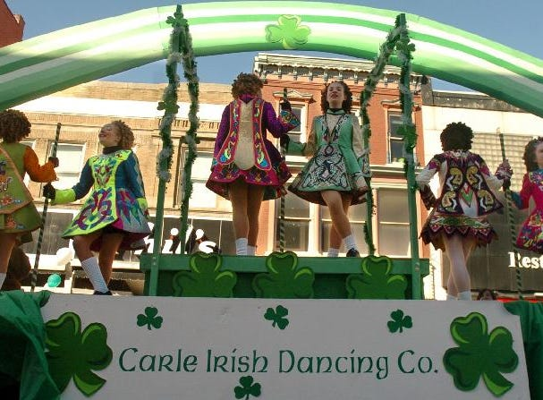 2005: Members of the Carle Irish Dancing Co. perform for the crowd on top of a float during the St. Patrick's Day parade Saturday in Binghamton.
