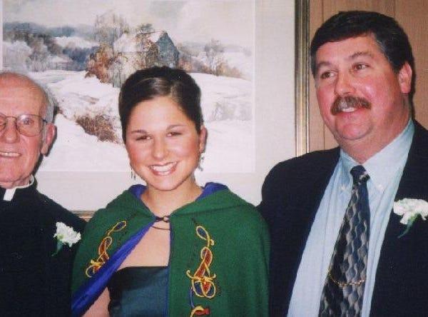 2003: Binghamton St. Patrick's Day Parade Grand Marshal Rev. Gerald Buckley, Maid of Erin Meghan Whalen and Official Starter Brian Faughnan, Binghamton fireman.