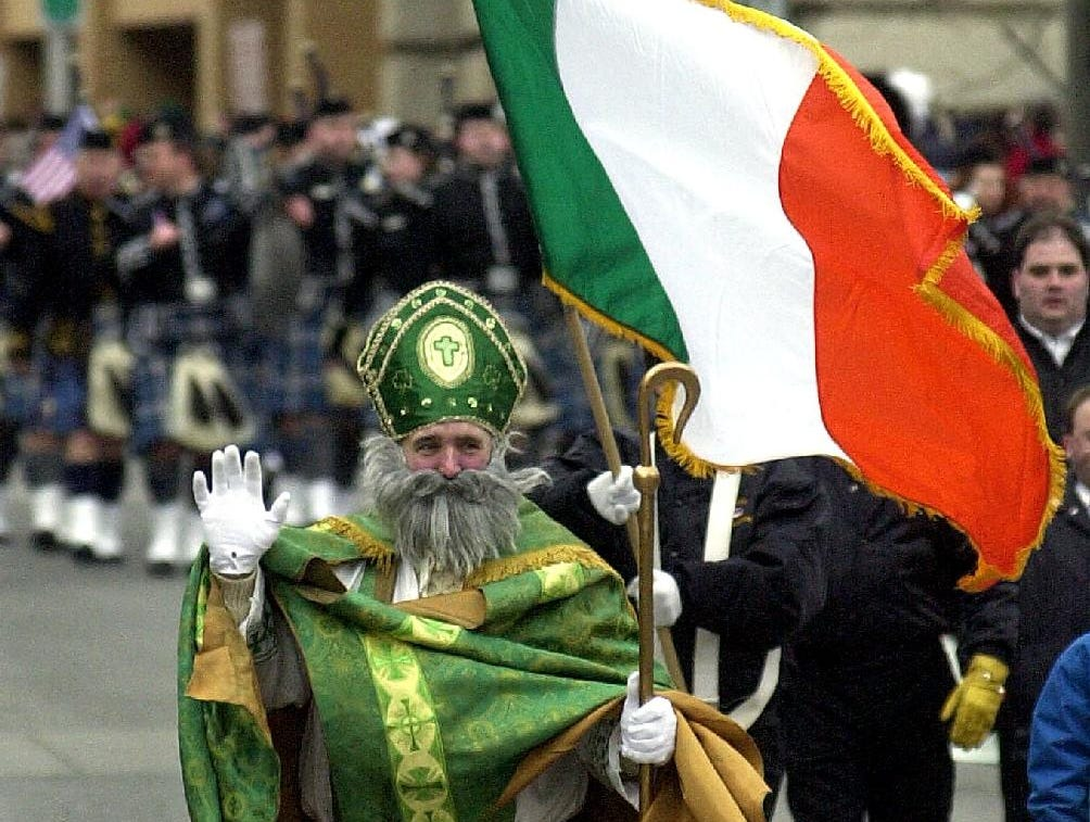 2002: St. Patrick was one of the first of a long line of parade participants to follow the green stripe down Court Street on Sat in downtown Binghamton.