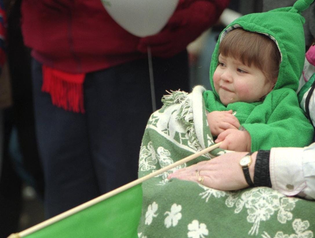 1998:  With an Irish flag and a shamrock blanket Lauren Ortego, 2, of Endicott shows her Irish pride waiting for the start of the St. Patricks day parade in BInghamton.