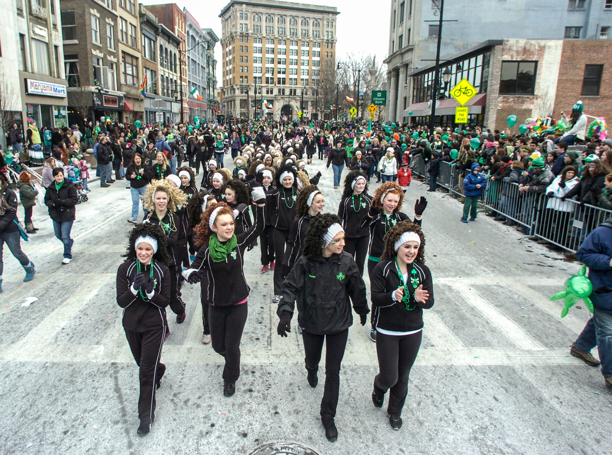2014: Girls from the Carle Irish Dancers perform down Court Street during the 47th annual St. PatrickÕs Day Parade in downtown Binghamton on Saturday.