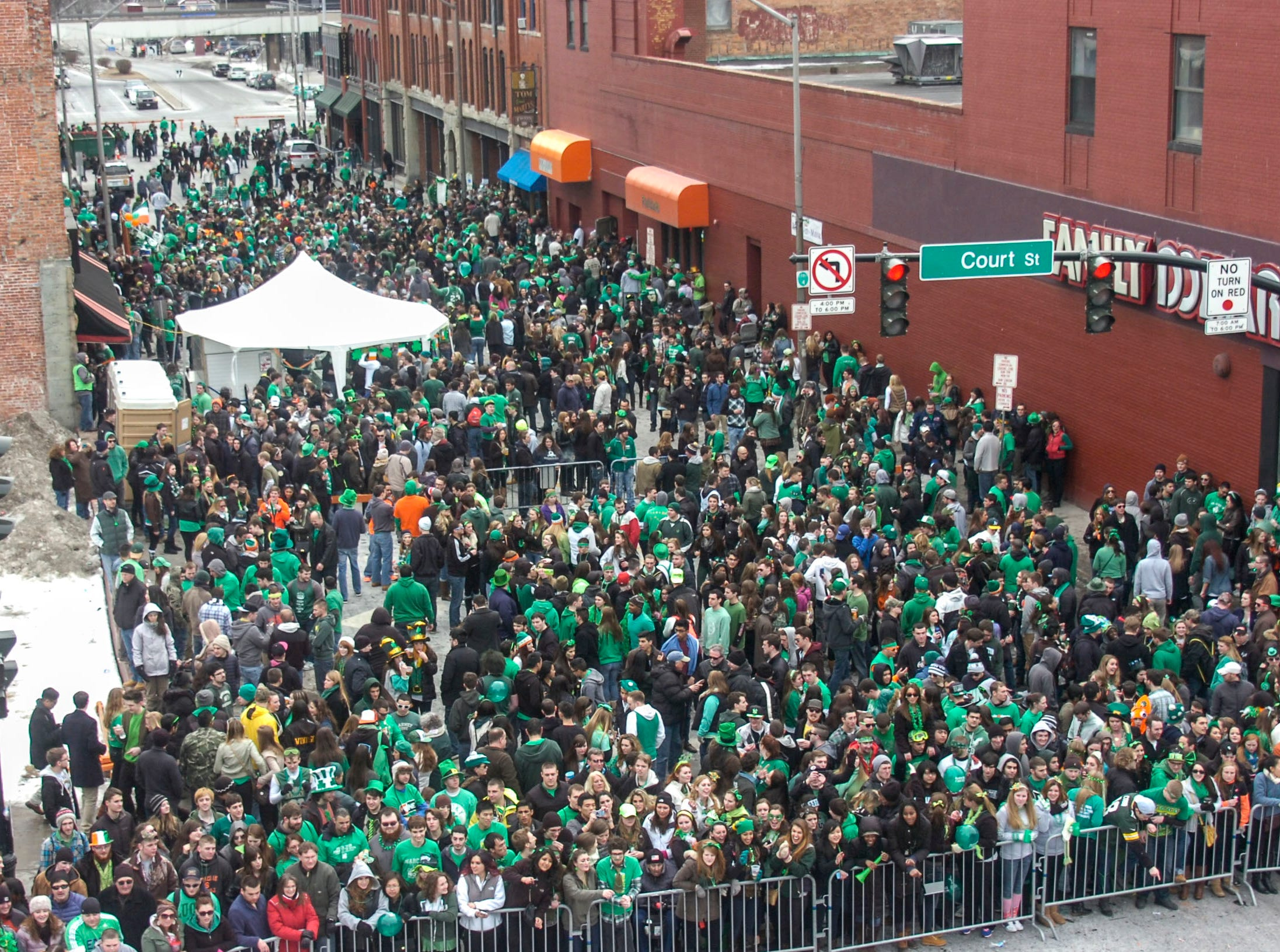 2014: Crowds of people fill State Street during the 47th annual St. PatrickÕs Day Parade in downtown Binghamton on Saturday.