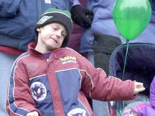 2001: Seven-year-old Corey Tarvin of Binghamton dances to the music at the annual St. Patrick's Day parade in downtown Binghamton.