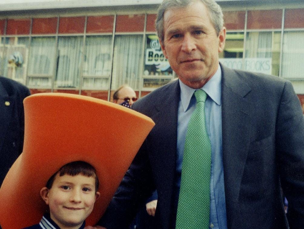 2000: Joseph gray, age 9, and George W. Bush meet at the St. Patrick's Day parade