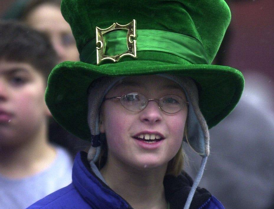 2003: Caitie Barrett, 10, of Vestal (top) and her sister Caroline Barrett, 4, watch the annual Binghamton St. Patrick's Day Parade on Saturday.
