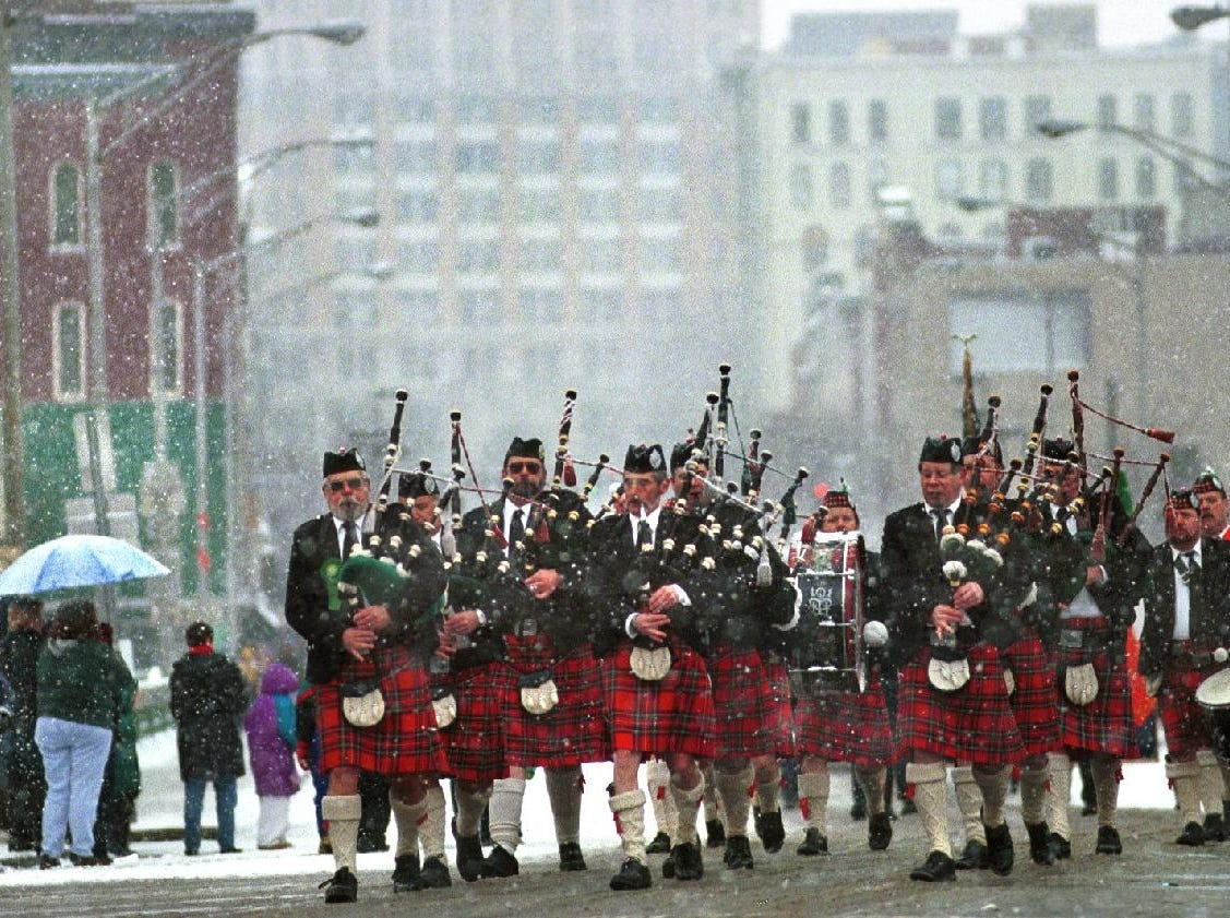 1999: The Penn York Highlanders from Athens Pa., make their way along Main Street in Binghamton Saturday afternoon in the St. Patricks Day Parade.
