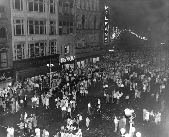 Crowds celebrate the end of World War II on Chenango Street in Binghamton in 1945.