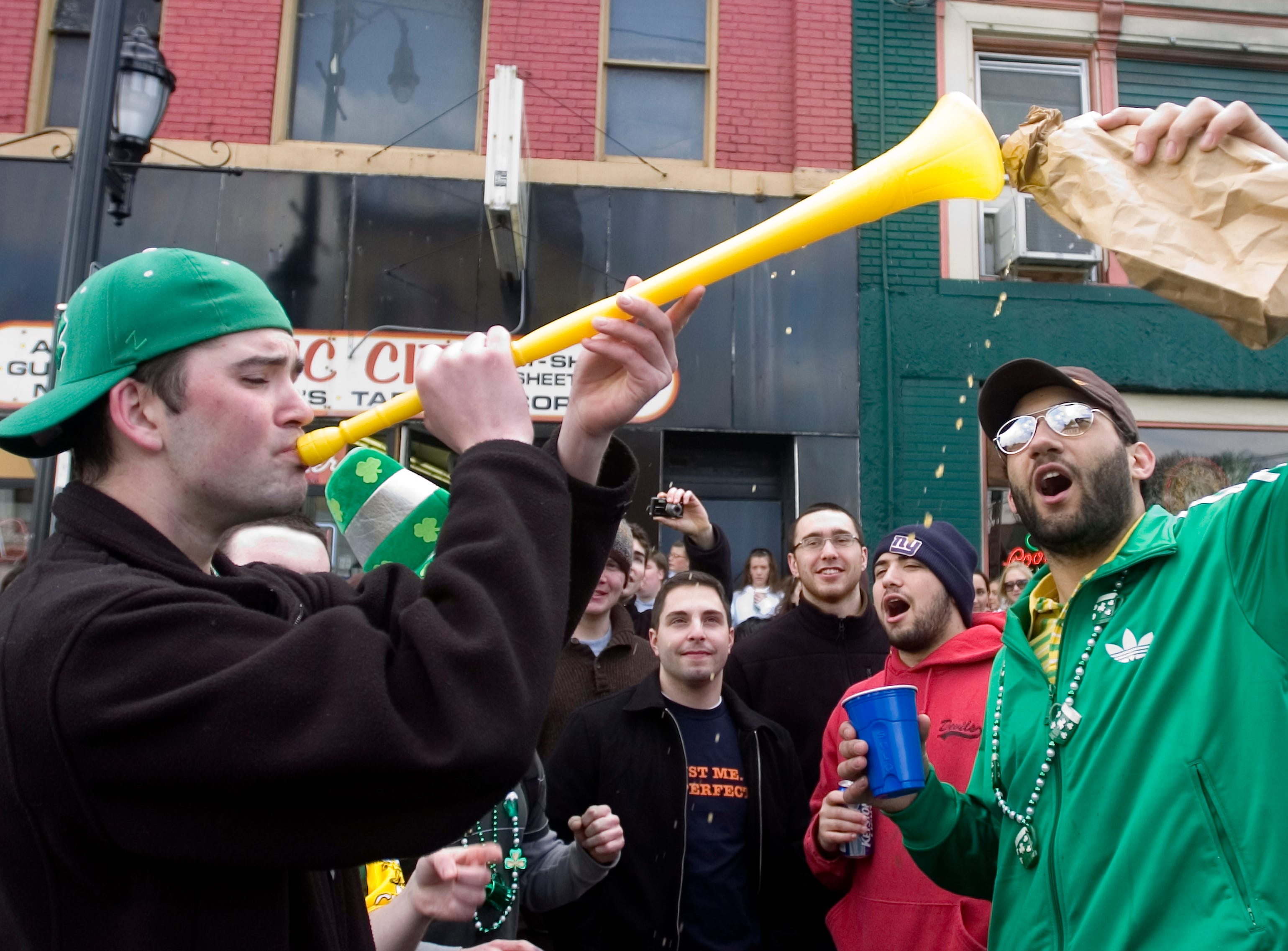 2007: Brian Nicoll, 21, left, of Long Island and Brandon Unger, 24 a Binghamton University student party at the annual BinghamtonÕs St. PatrickÕs Day Parade on Saturday.