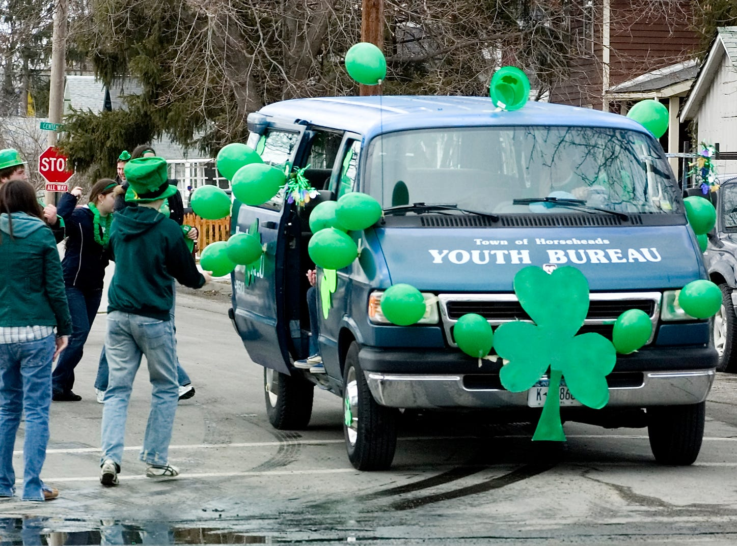 2007: Members of the Horseheads Youth Bureau prepare to climb in a youth bureau van decorated for Sunday's St. Patrick's Day parade in Horseheads.