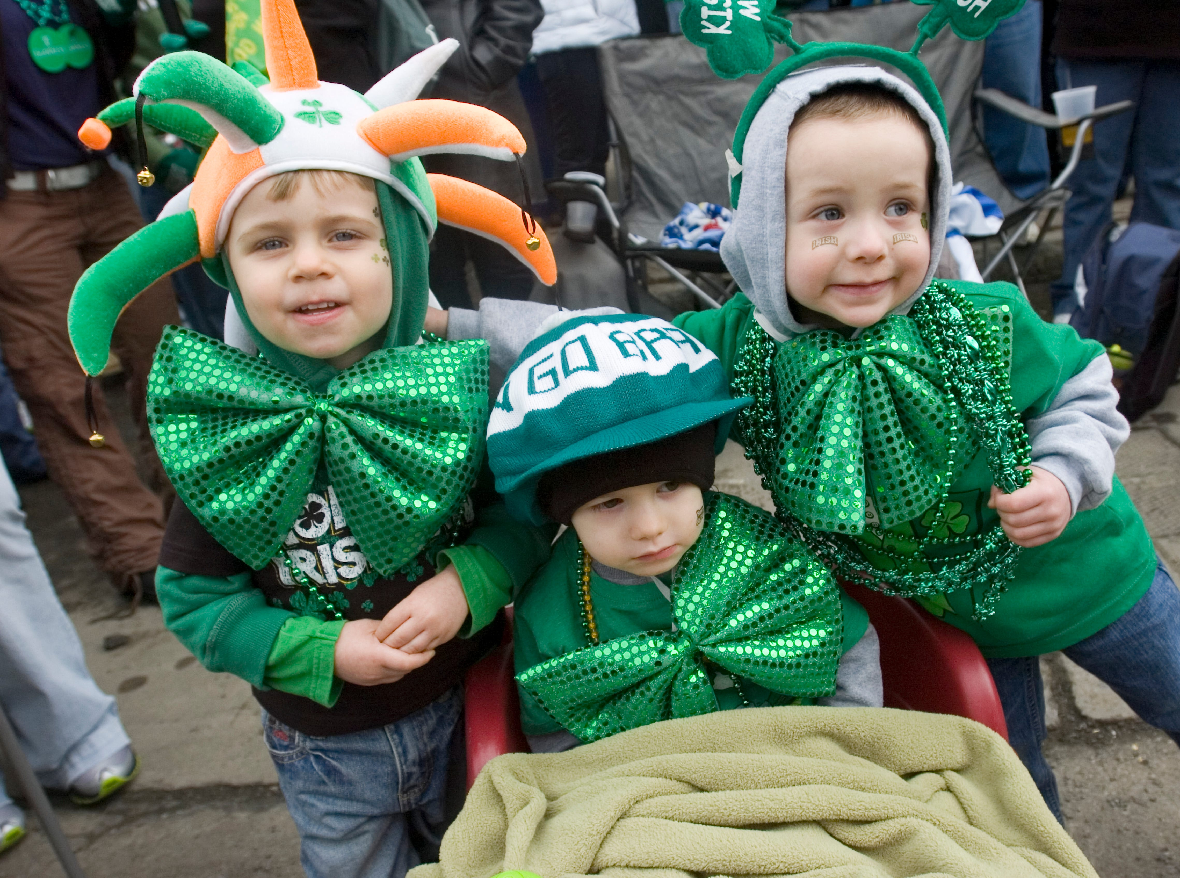 2011: Cousins, from left, Caden Hogeboom, Carson Sedlak, and Kameron Kelly, all three-years-old from Endicott, attend the 44th annual St. Patrick's Day parade is held in downtown Binghamton on Saturday.