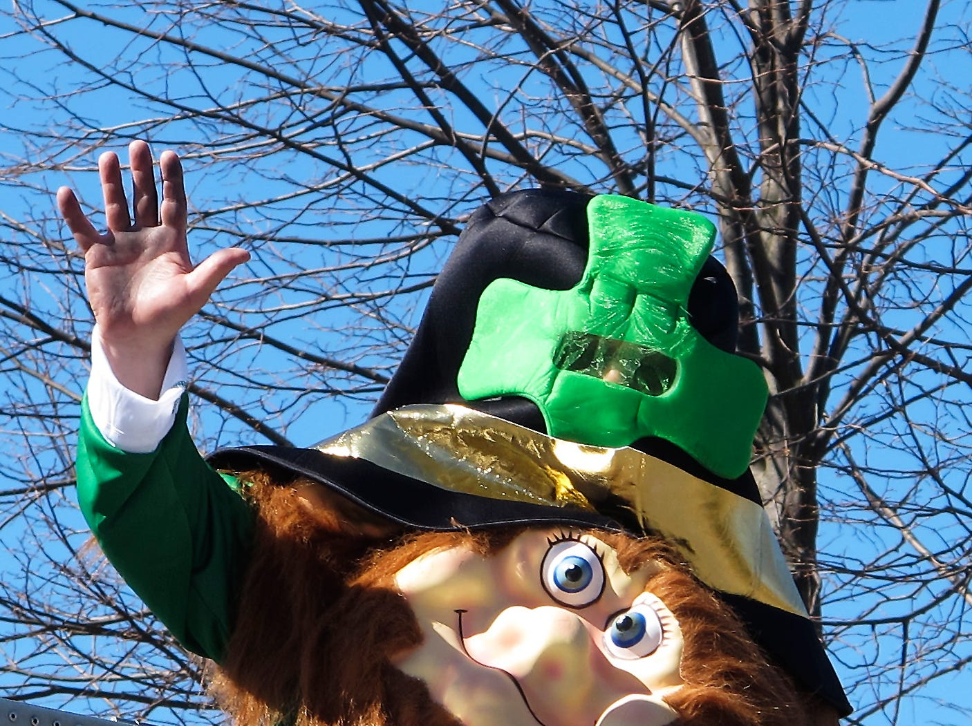 2012:  A Horseheads Fire Department leprechaun waves at spectators during Sunday's St. Patrick's Day parade through the village.