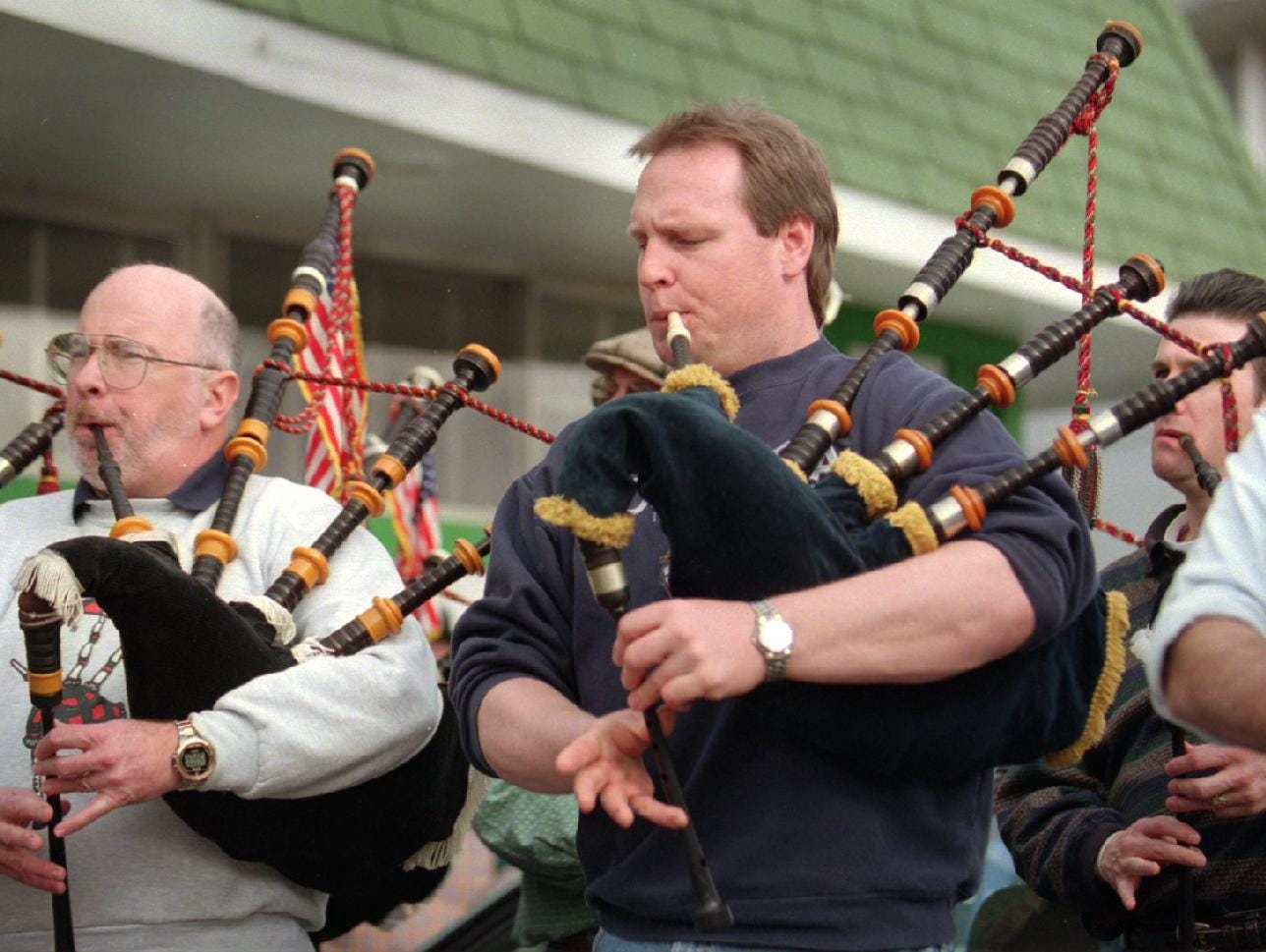 1998: Paul Newman a captain of the Stamford CT, fire department practices with the Westchester Firefighters Emerald Pipe & Drums band in front of the Ancient Order of Hibernians on Main Street in Binghamton.