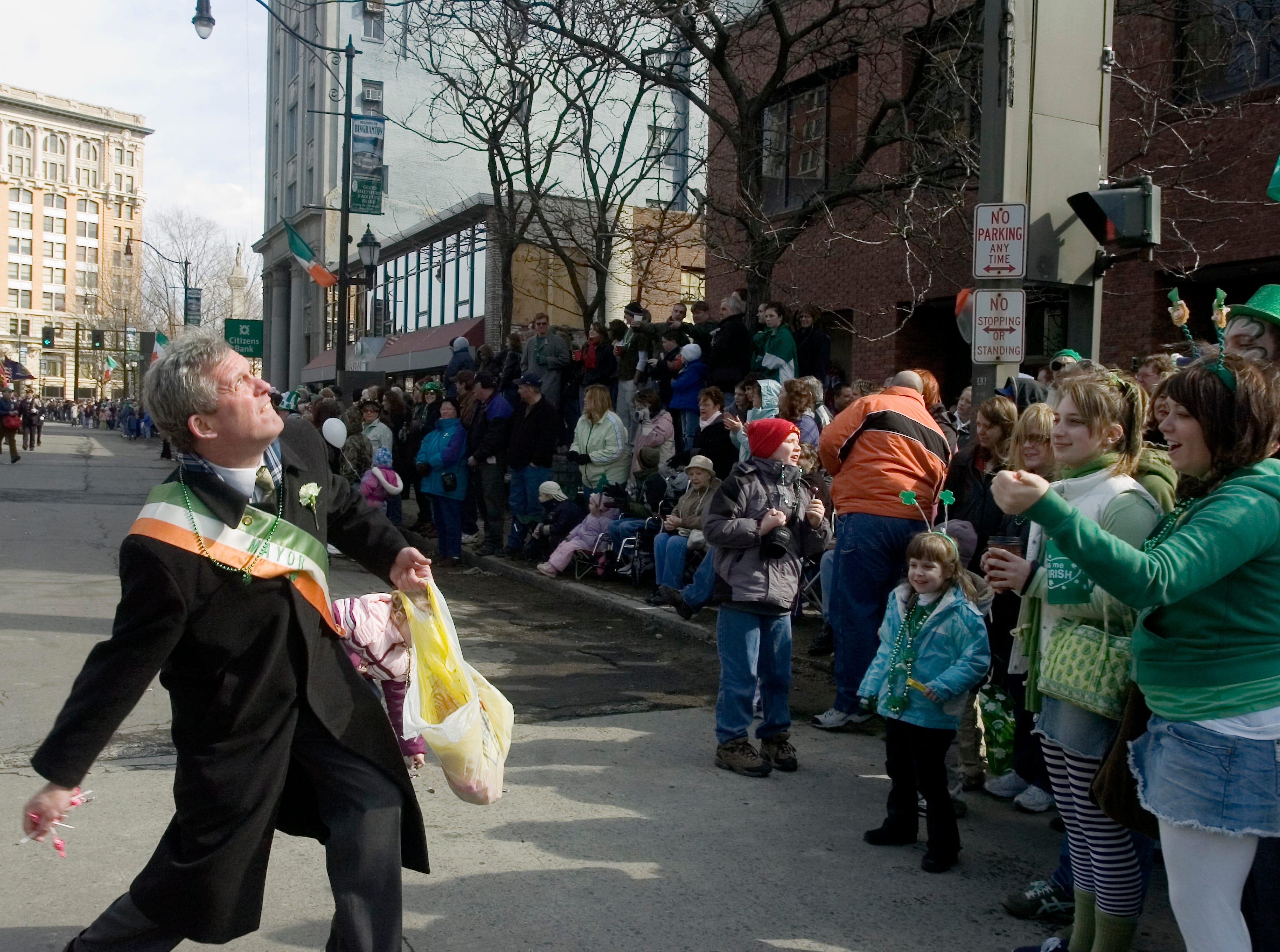 2007: Mayor Matt Ryan throws candy to spectators at the annual BinghamtonÕs St. PatrickÕs Day Parade on Saturday.