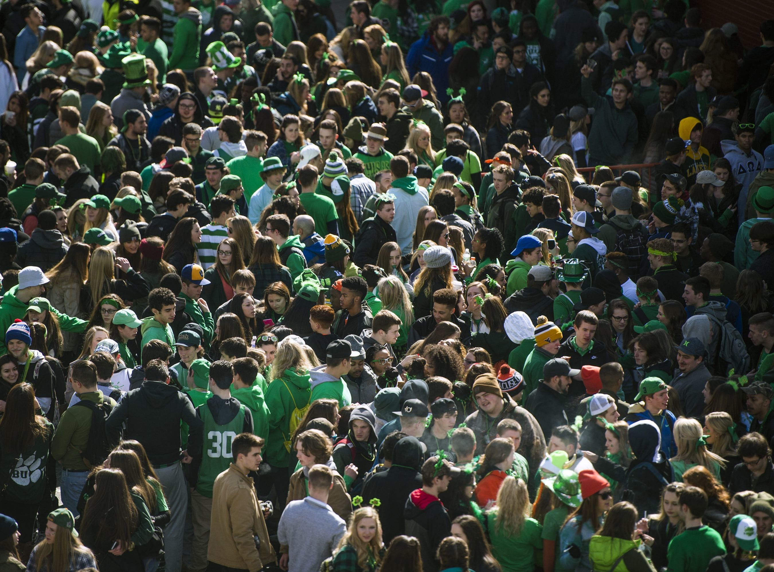 2017: Students pack State Street in downtown Binghamton before the start of the 49th annual St. Patrick's Day Parade.