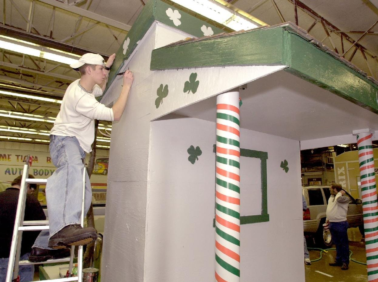 2001: BOCES student Coy Reynolds paints some lettering on their St. Patrick's Day Parade float that will appear in today's parade.