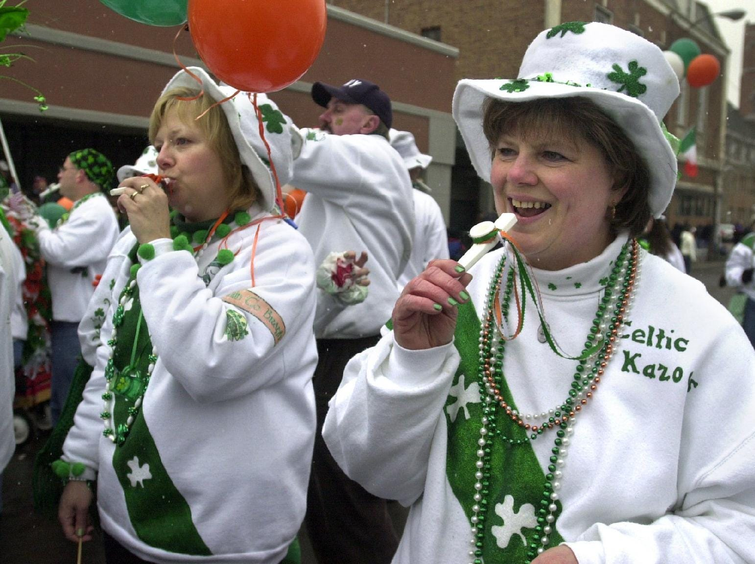 2003: During the St. Patrick's Day Parade in Binghamton on Saturday, Kathy Rodzinka of the Town of Conklin (left) and Linda Sisson of Chenango Bridge play with the Celtic Kazoo.