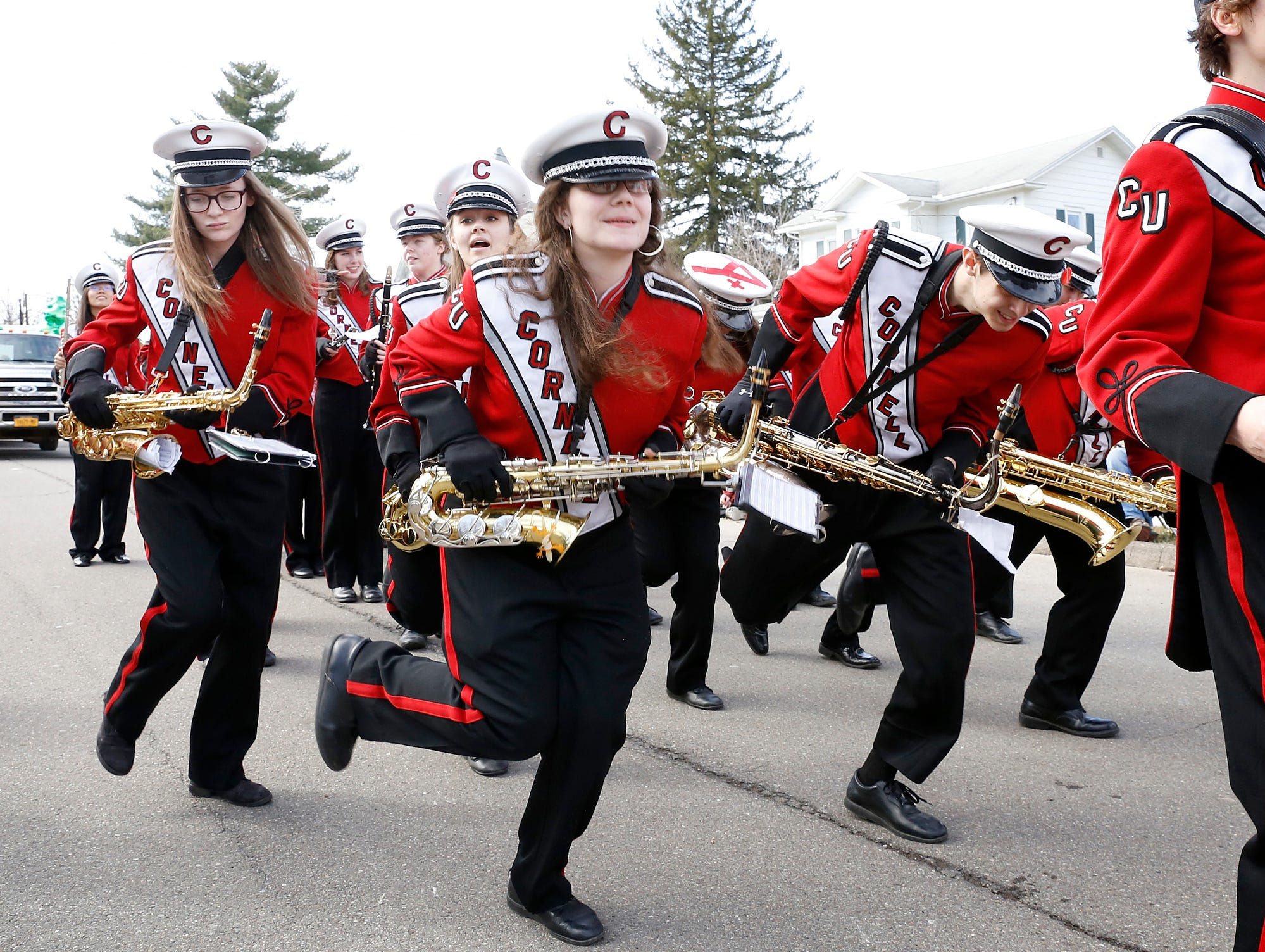 2016: While waiting for the parade train to move forward, the saxophone section of the Cornell University Big Red Marching Band moves to a choreographed dance Saturday at the St. Patrick's Day Parade in Horseheads.