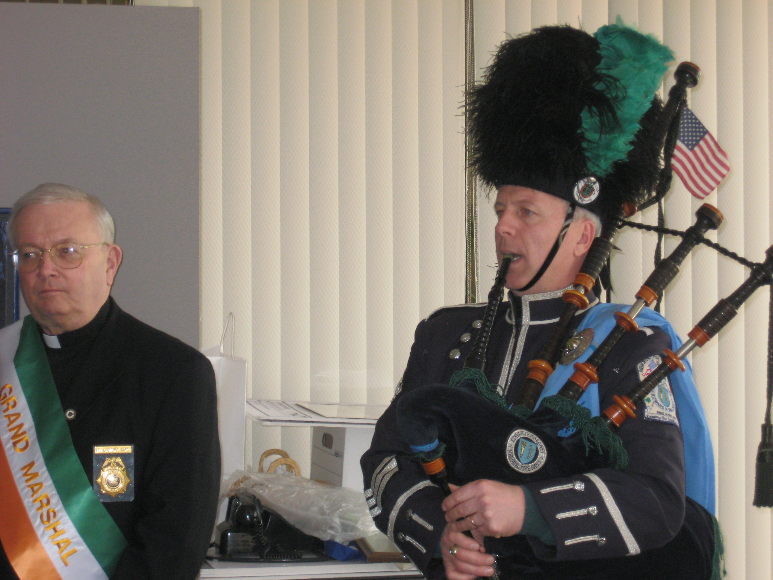 2010: Rich Maloney, a Binghamton firefighter, plays his bag pipes at a city hall press conference promoting Saturday's St. Patrick's Day Parade. Maloney will be in the parade with the Maloney Memorial Pipe Band. Next to him is the Rev. Laurence Lord, this year's grand marshall.