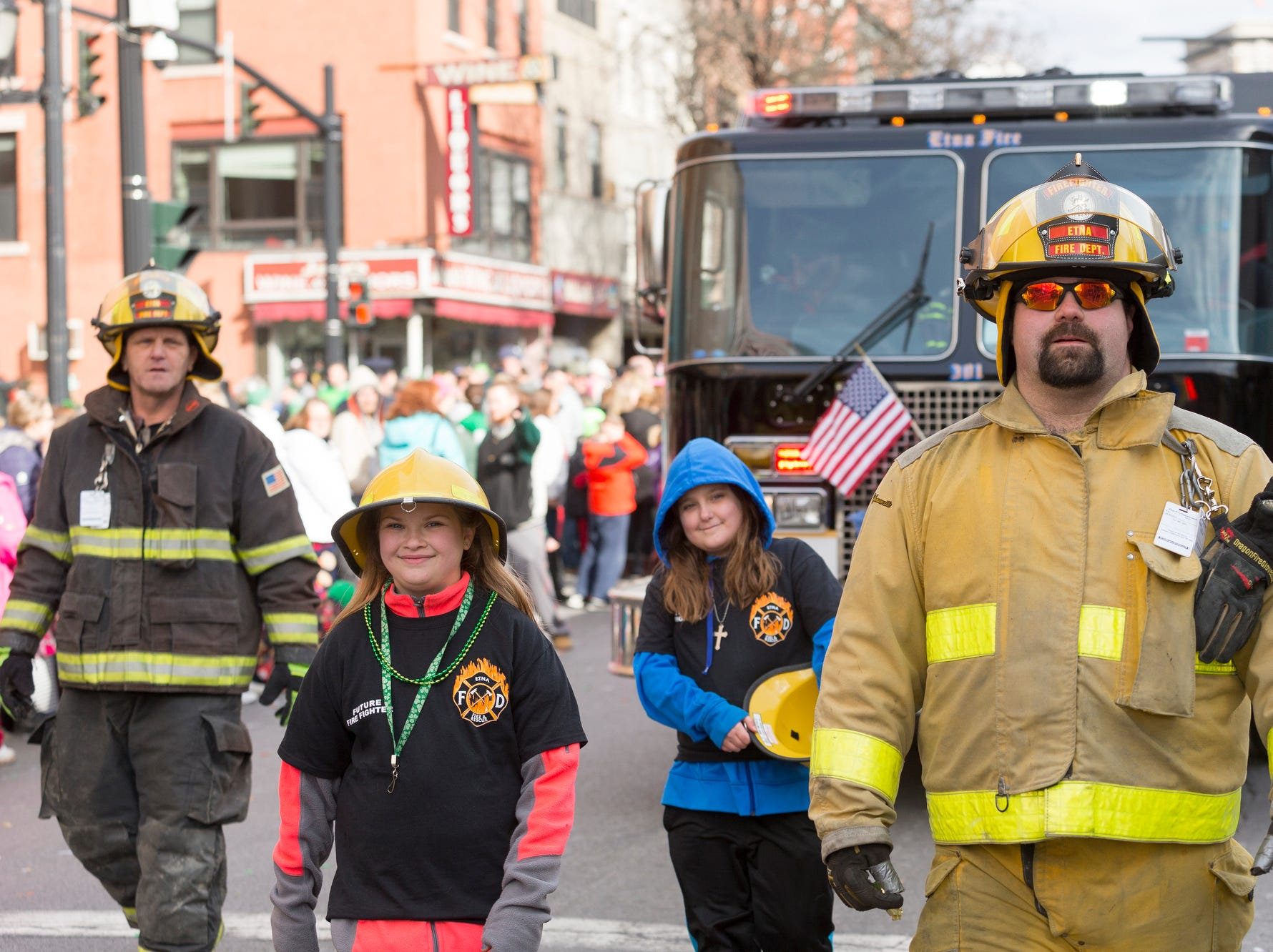 2016: Members of the Etna Volunteer Fire Department march in the 49th annual St. Patrick's Day Parade, Saturday in Binghamton. From left, Firefighter Dave Fuller, future firefighters Addison Lawrence, and Fuller's daughter Nikki, and Firefighter Mike Ayers.