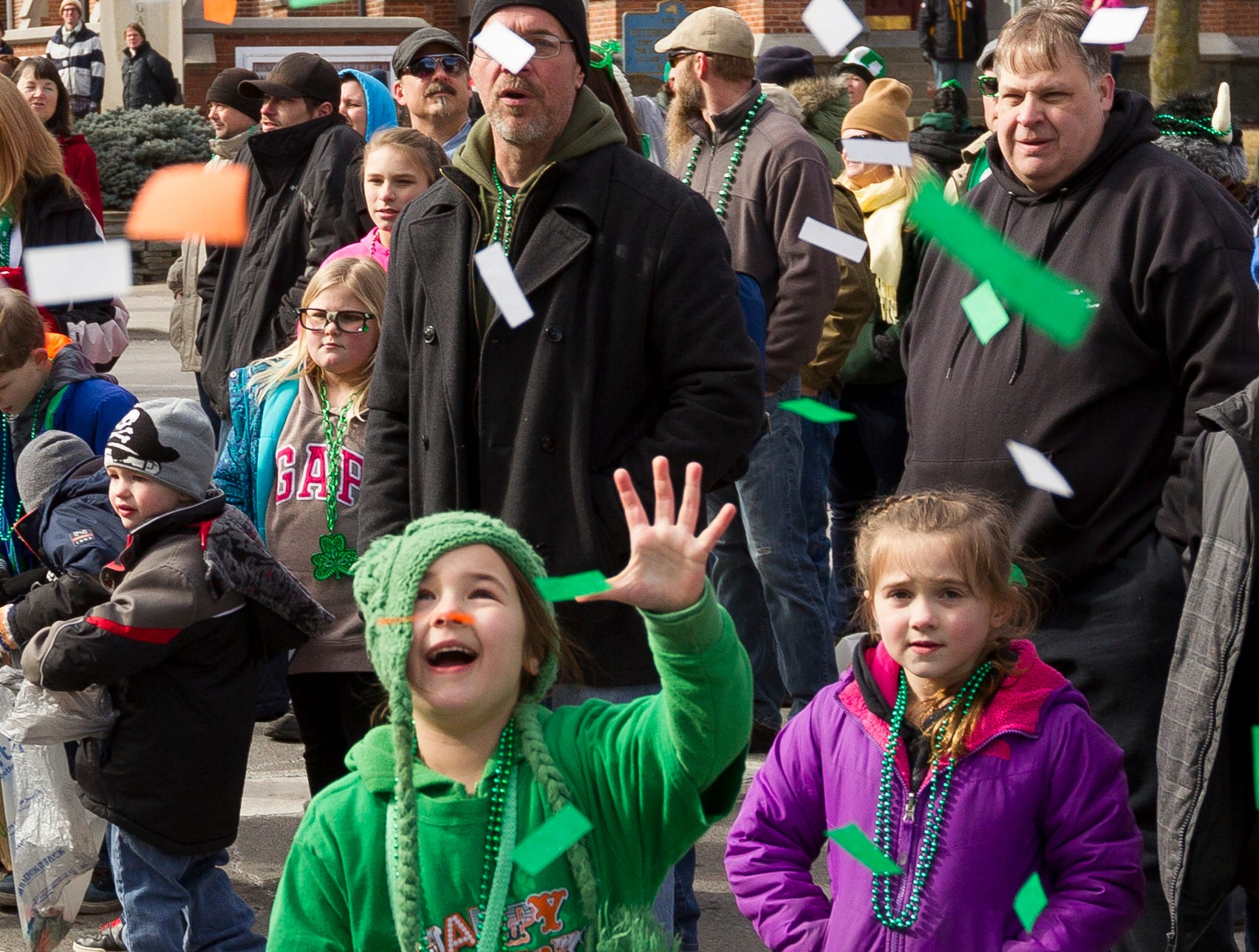 2016: Confetti from the St. Patrick's Church floats down on the spectators Saturday at Binghamton's 49th annual St. Patrick's Day Parade  on Court Street near Front Street.