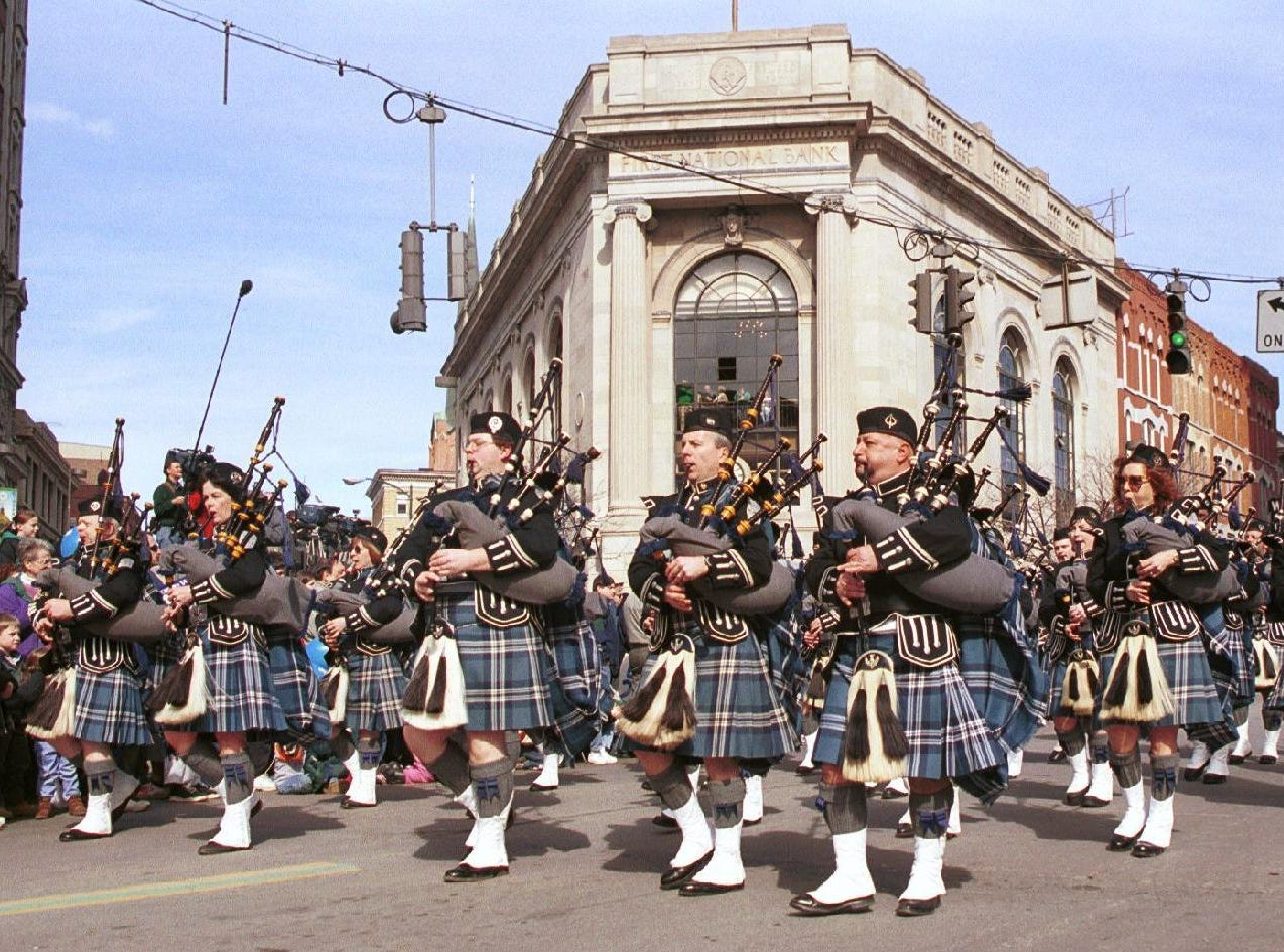 1999: A pipe band performs on Court Street during the 1999 St. Patrick's Day parade in downtown Binghamton.