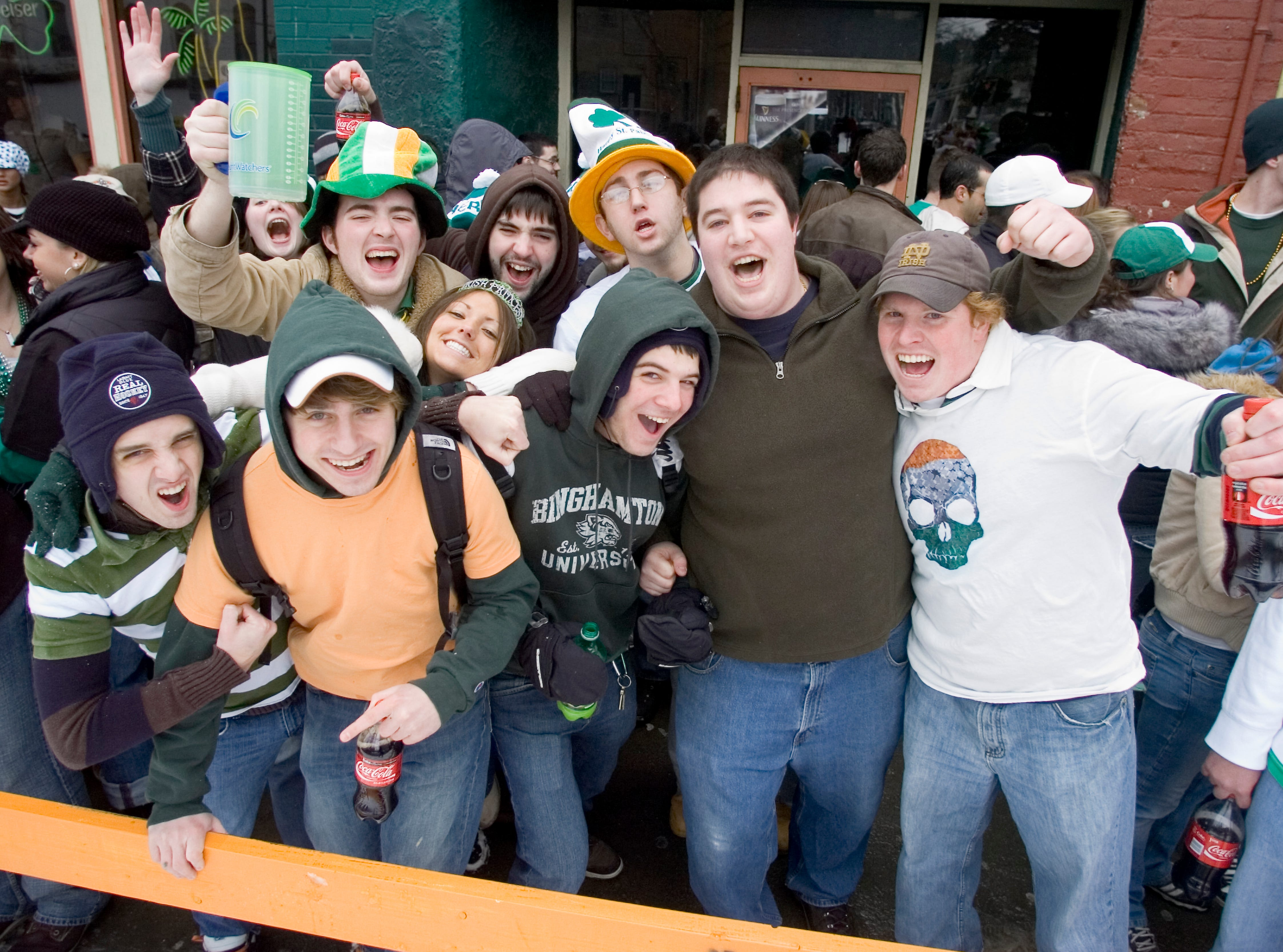 Parade goers gather on Main Street on Saturday for the St. Patrick's Day Parade in Binghamton.
