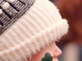1997: Three-year-old Nicolas Butler is clad in his hat to keep warm and bears a shamrock at the St. Patrick's Day parade in downtown Binghamton on Saturday.