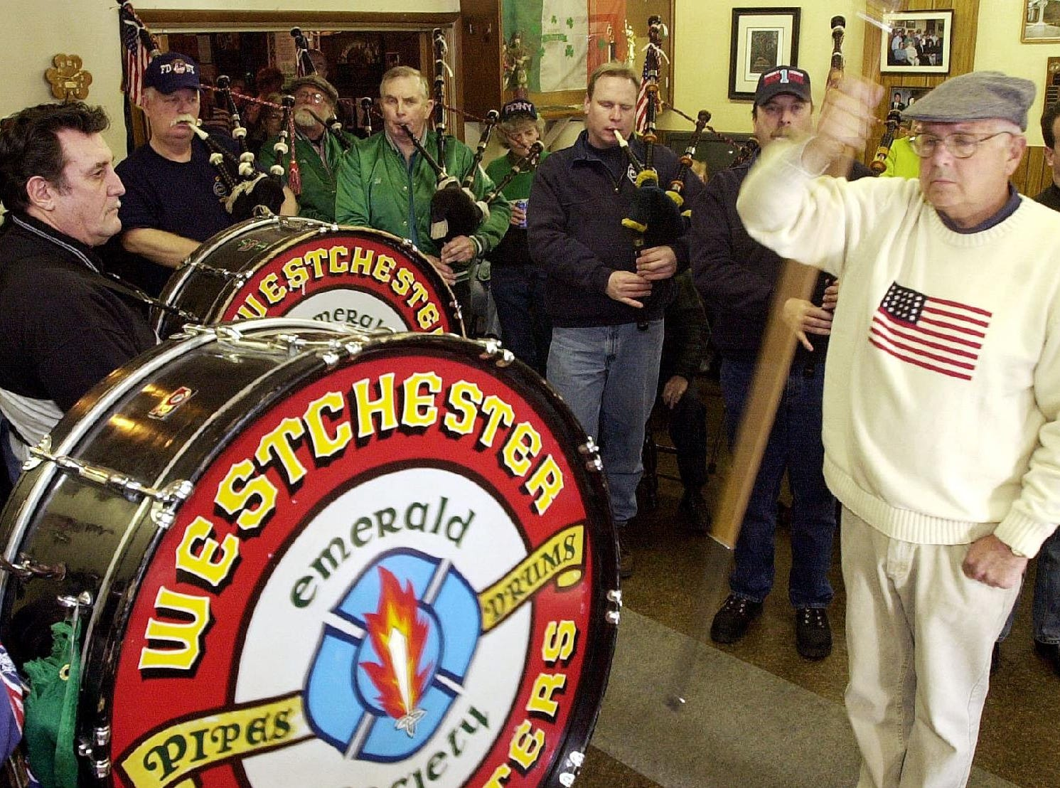 2002: Members of the Pipes and Drums Firefighters Emerald Society of Westchester, led by Drum Major John Cullen, far right, play a few songs at the Ancient Order of Hibernians on Main Street in Binghamton Friday afternoon. They will be one of the bands featured in Saturday's St. Patrick's Day Parade in downtown Binghamton.
