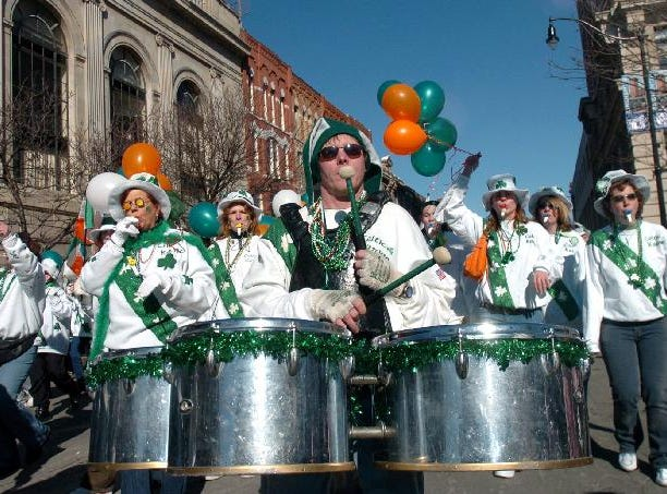 2005: Kevin Riley of Binghamton, middle, plays percussion for the Broome County Celtic Kazoos during the St. Patrick's Day parade saturday in Binghamton.
