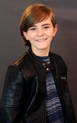 "Eamonn Hubert, 10, of Endicott, is a swing  in the touring cast of the hit musical ""School of Rock."""