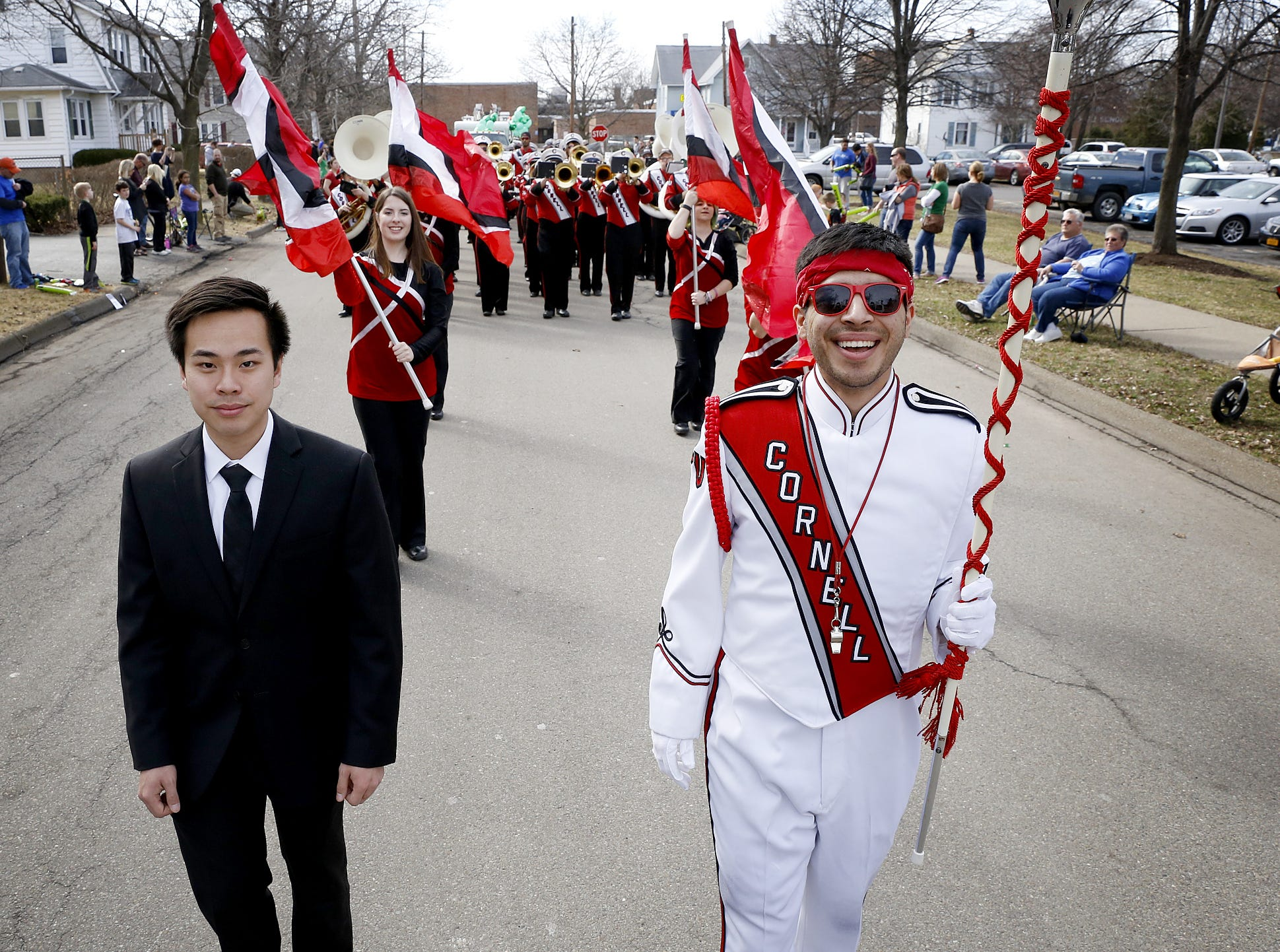 2016: Cornell University Big Red Marching Band acting head manager Jeffrey Van, a freshman, left, and drum major Sergio Preciado, a junior, leads the band Saturday during the St. Patrick's Day Parade in Horseheads.