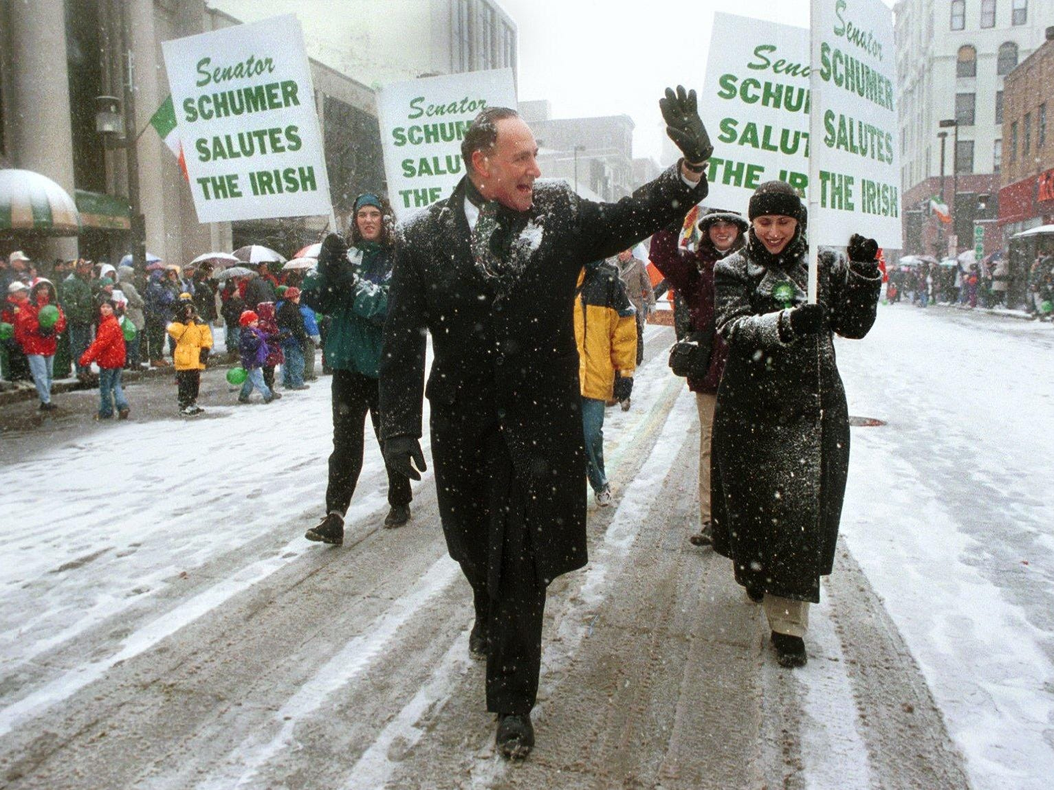 1999: United States Senator Charles Schumer, Democrat from New York, makes his way down a snow covered Court Street in downtown Binghamton, N.Y. Saturday afternoon during the St. Patricks Day Parade.