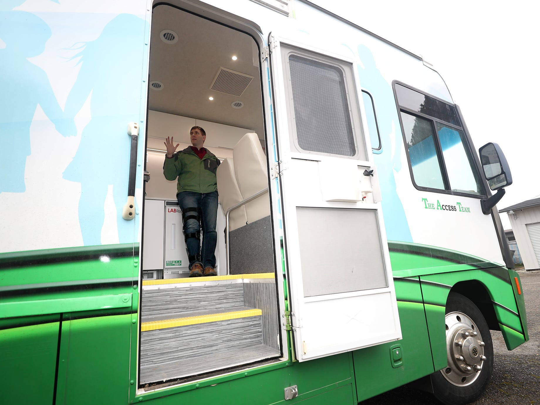 Peninsula Community Health Associate Medical Director Anthony Lyon-Loftus is framed in the doorway of their Mobile Primary Care unit as he talks about the vehicle on Wednesday, February 27, 2019.